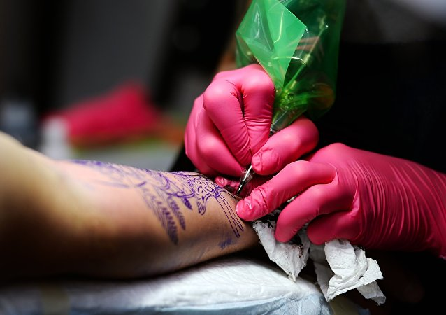 Getting a tattoo (photo used for illustration purpose only)