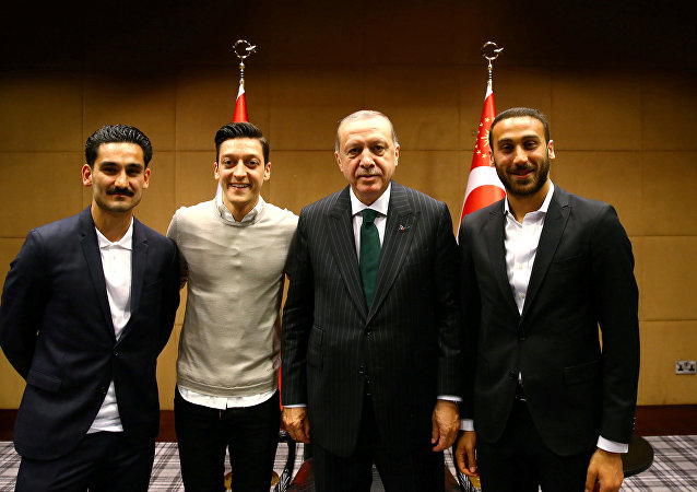 Turkish President Tayyip Erdogan meets with Premier League soccer players Ilkay Gundogan of Manchester City, Mesut Ozil of Arsenal and Cenk Tosun of Everton in London, Britain May 13, 2018