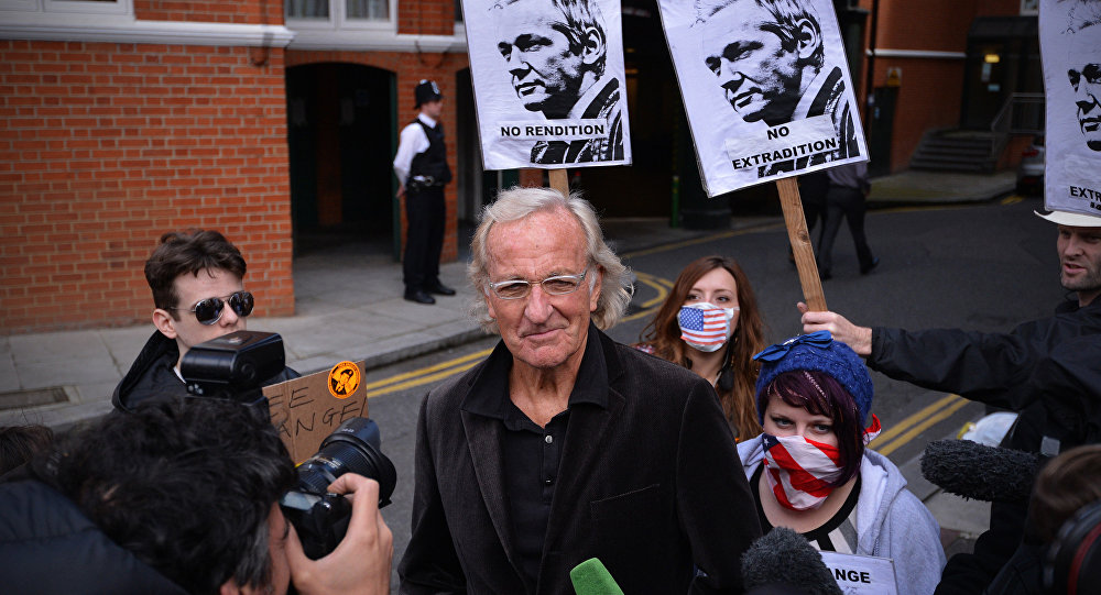 John Pilger, Australian journalist and friend of Wikileaks founder Julian Assange, speaks to the media outside the Ecuadorian embassy in London, on June 22, 2012, where Assange is seeking political asylum