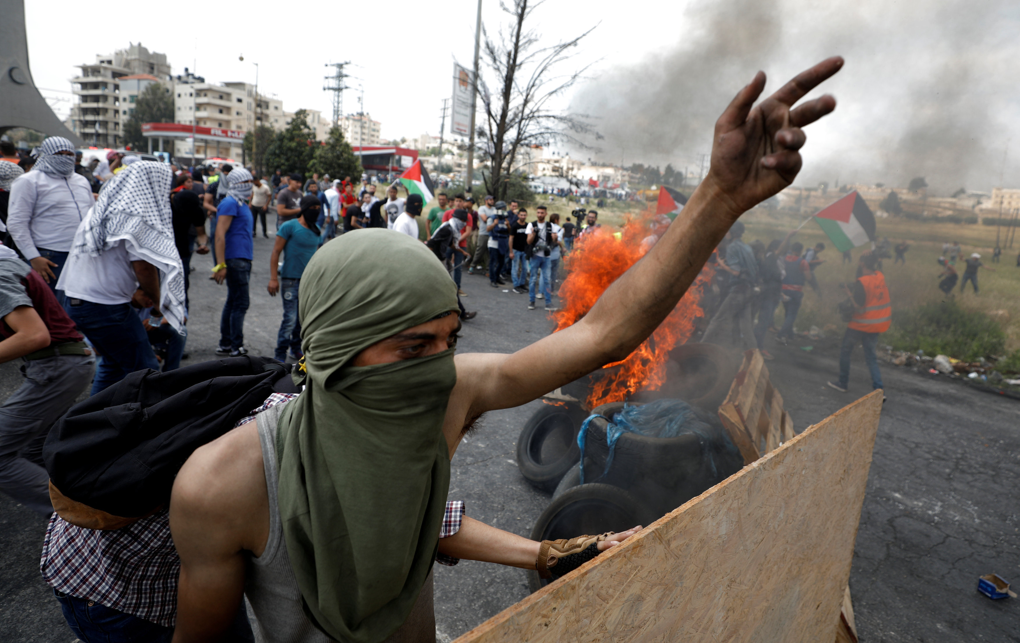 A Palestinian demonstrator gestures during a protest marking the 70th anniversary of Nakba, near the Jewish settlement of Beit El, near Ramallah, in the occupied West Bank May 15, 2018