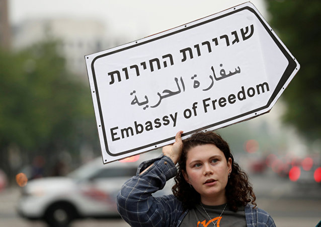 Hannah Boroff takes part in a protest outside of Trump International Hotel against the new U.S. Embassy opening in Jerusalem in Washington, U.S., May 14, 2018