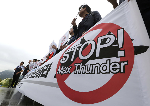 South Korean protesters stage a rally against the Max Thunder joint military exercise between the United States South Korea near the U.S. embassy in Seoul, South Korea, Wednesday, May 16, 2018.