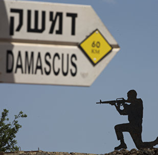 A mock road sign for Damascus, the capital of Syria, and a cutout of a soldier, are displayed in an old outpost in the Israeli controlled Golan Heights near the border with Syria, Thursday, May 10, 2018