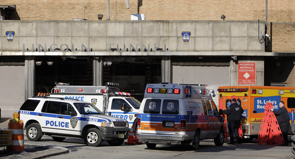 Emergency personnel load backboards into an ambulance at the exit to the Lincoln Tunnel in New York (File)