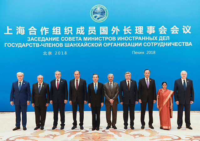 Foreign ministers and officials of the Shanghai Cooperation Organisation (SCO) pose for a group photo before a meeting at the Diaoyutai State Guest House in Beijing, China, April 24, 2018.