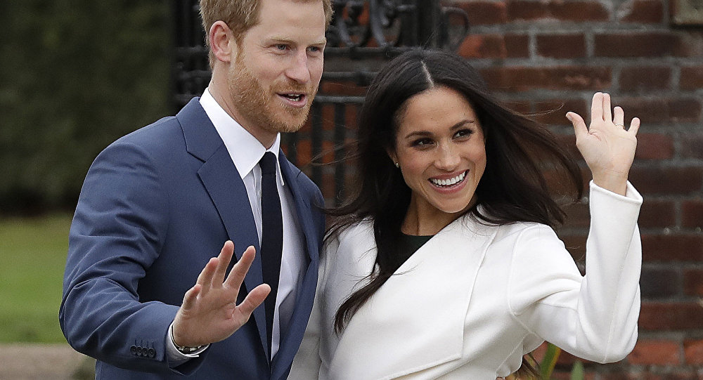 Britain's Prince Harry and his fiancee Meghan Markle pose for photographers during a photocall in the grounds of Kensington Palace in London, Monday Nov. 27, 2017