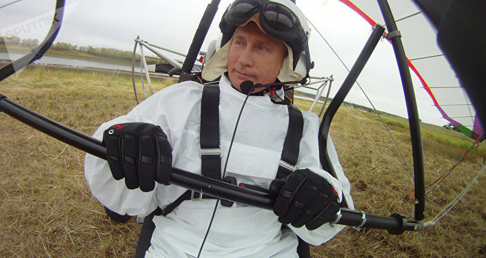 Russian President Vladimir Putin (right) takes part in a scientific experiment as part of the Flight of Hope