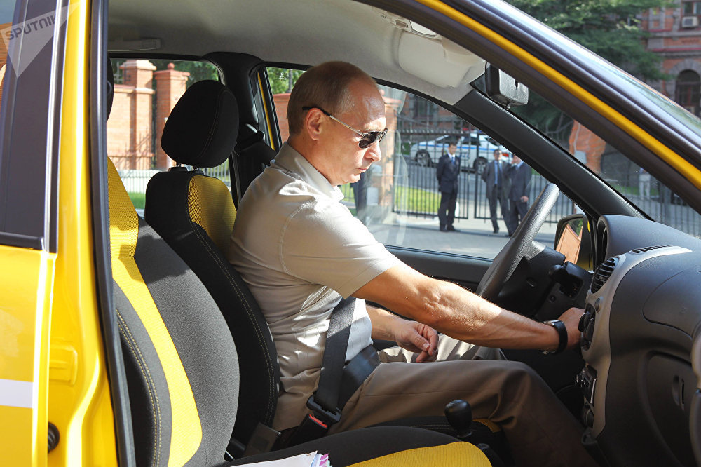 August 27, 2010. Prime Minister Vladimir Putin driving along the Chita-Khabarovsk highway in a Lada Kalina