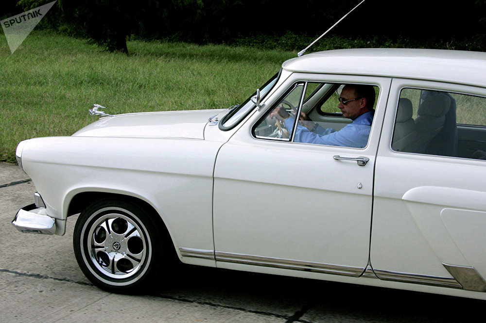 Russian President Vladimir Putin driving a 1956 Gaz-21 Volga built at the opening of the Adler-Krasnaya Polyana tunnel near Sochi in 2005.