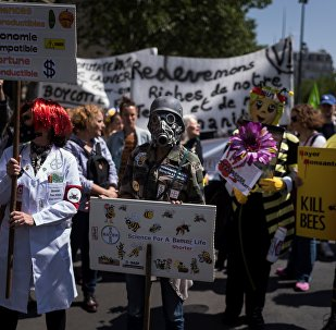 People take part in a demonstration to protest against industrial giants Monsanto, Bayer and Syngenta at the Place de la Republique in Paris on May 19, 2018