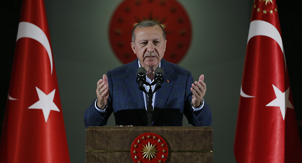 Turkey's President Recep Tayyip Erdogan speaks during an Iftar, the evening meal breaking the Ramadan fast, at his palace in Ankara, Turkey, Saturday, May 19, 2018