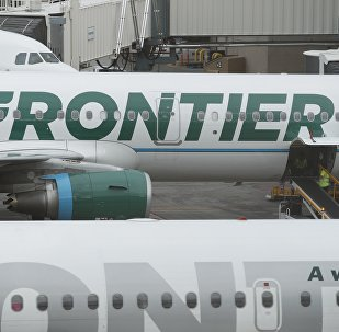 In this Monday, May 15, 2017, photograph, the company logo is showcased on the side of a Frontier Airlines airplane waiting at a gate on Concourse A in Denver International Airport in Denver
