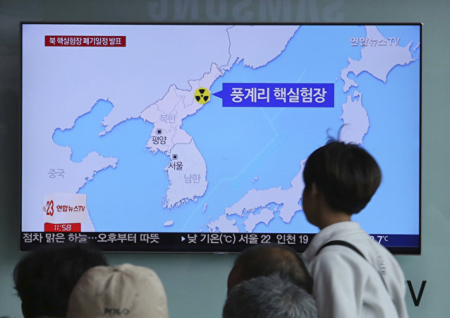 People watch a TV screen reporting that North Korea will dismantle nuke test site during a news program at the Seoul Railway Station in Seoul, South Korea, Sunday, May 13, 2018