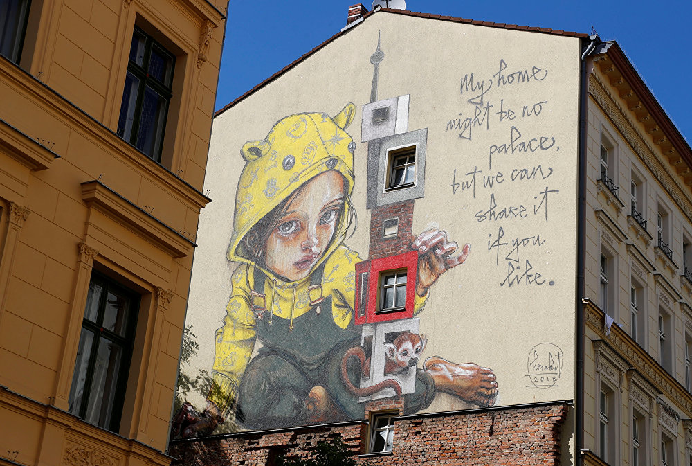 Artwork by urban artist Herakut is pictured as part of the first Berlin Mural Fest 2018