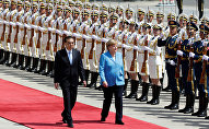 German Chancellor Angela Merkel and Chinese Premier Li Keqiang review the guard of honour during a welcome ceremony outside the Great Hall of the People in Beijing, China May 24, 2018