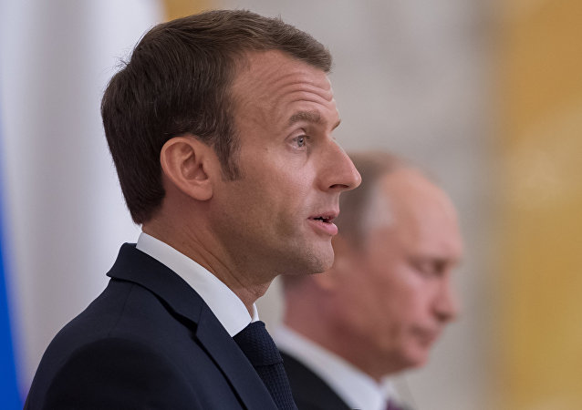 French President Emmanuel Macron during a joint presser with Vladimir Putin