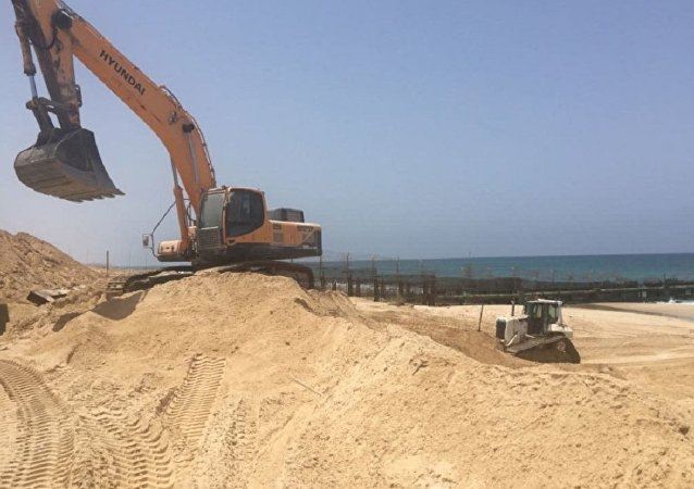 Construction on a new barrier along the sea in Gaza