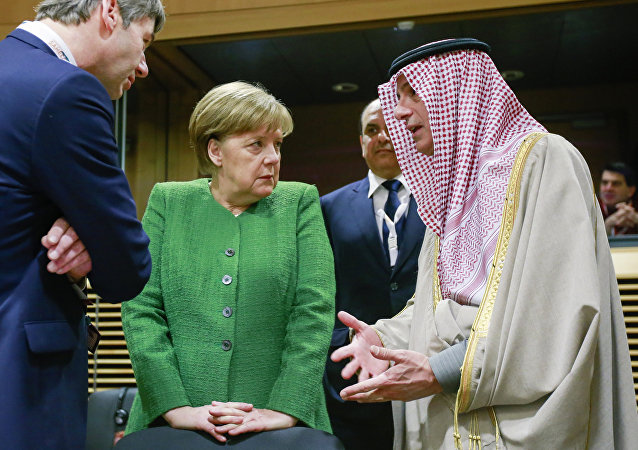 Germany's Chancellor Angela Merkel (C) speaks with Saudi-Arabia's Foreign Minister Adel al-Jubeir (R) as they arrive to attend a High Level Conference on the Sahel at the European Commission in Brussels on February 23, 2018