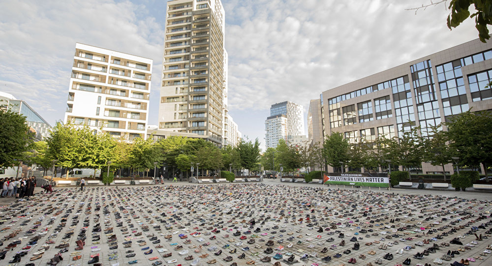 4,500 pairs of shoes are laid out in front of the European Parliament in Brussels ahead of the EU Foreign Affairs Council meeting by AVAAZ members on Monday, May 28, 2018. The AVAAZ campaign, Palestinian Lives Matter, are highlighting the Gaza tragedy with 4,500 pairs of shoes representing one pair for every life lost in this conflict in the last decade, in front of where ministers enter the Parliament building