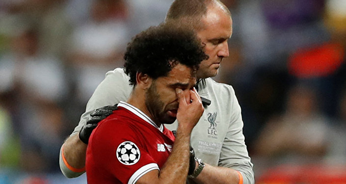 Soccer Football - Champions League Final - Real Madrid v Liverpool - NSC Olympic Stadium, Kiev, Ukraine - May 26, 2018 Liverpool's Mohamed Salah looks dejected as he is substituted off due to injury