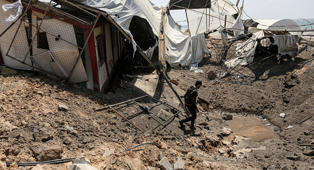 A man inspects the damage at a site targeted by an Israeli air strike a day before in Khan Younis in the southern Gaza strip on May 30, 2018