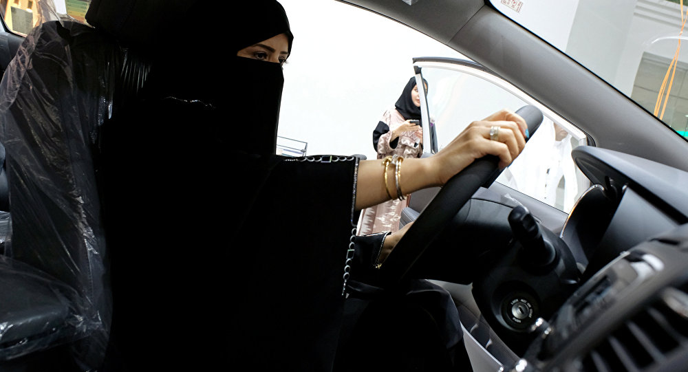A Saudi woman checks a car at the first automotive showroom solely dedicated for women in Jeddah, Saudi Arabia, Jan. 11, 2018