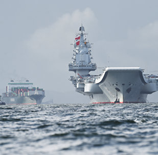 China's sole aircraft carrier, the Liaoning (R), arrives in Hong Kong waters on July 7, 2017, less than a week after a high-profile visit by president Xi Jinping
