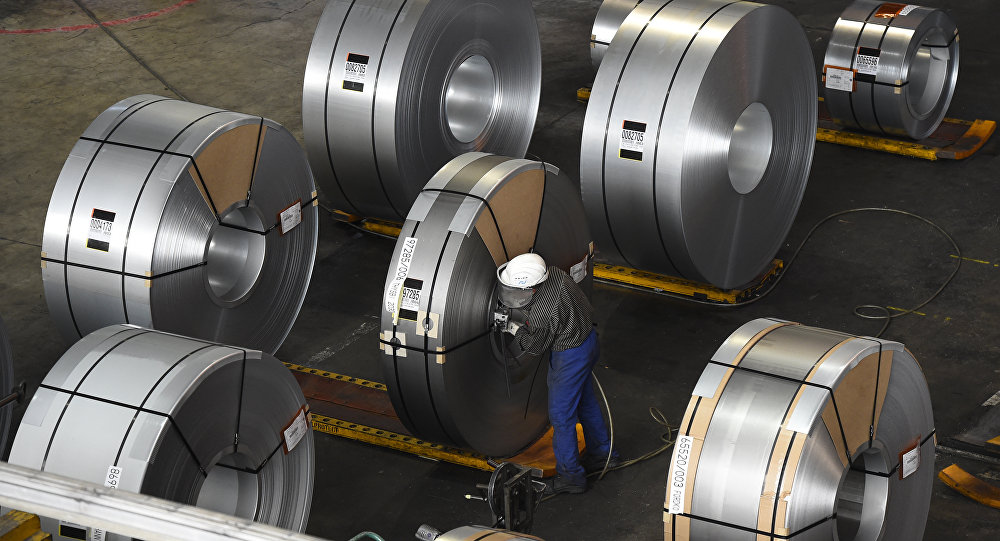(FILE) In this file photo taken on March 17, 2015 a worker packs coils for delivery at the production site of a German steel company in Salzgitter. Imposed stiff tariffs by the United States on European, Mexican and Canadian steel and aluminium, that have come into effect on June 1, 2018