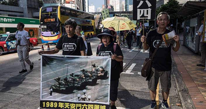 Protesters display a poster of the famous Tank Man standing in front of Chinese military tanks at Tiananmen Square in Beijing, during a rally in Hong Kong on May 28, 2017, ahead of the 28th anniversary of the June 4, 1989 Tiananmen Square crackdown