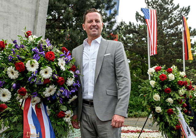 U.S. ambassador to Germany Richard Allen Grenell stands beside a wreath in Berlin, Germany, May 12, 2018