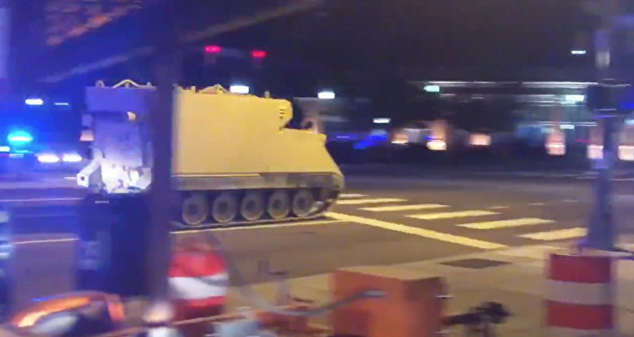 An armoured personnel carrier (APC), which was purpotedly stolen, drives along a street in Richmond, Virginia, U.S. June 5, 2018, in this still image taken from a video obtained from social media