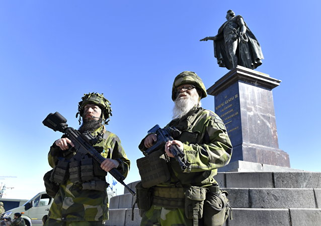 Reservist soldiers Konrad Lindblad (L) and Par Thorhard stand guard outside the Stockholm Palace during a military training exercise in Stockholm, Sweden, on June 6, 2018, Sweden's national day