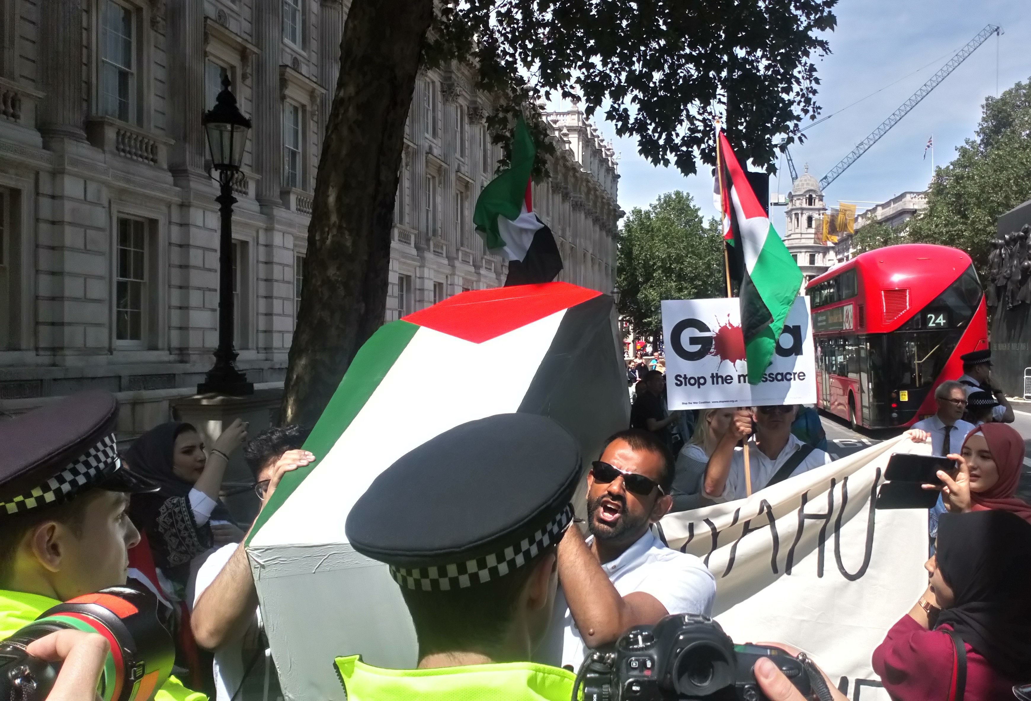 Pro-Palestinian protesters carry a coffin to 10 Downing Street