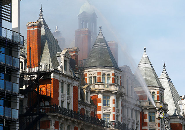 Firefighters tackle a blaze at the Mandarin Oriental Hotel in Knightsbridge, central London, Britain, june 6, 2018