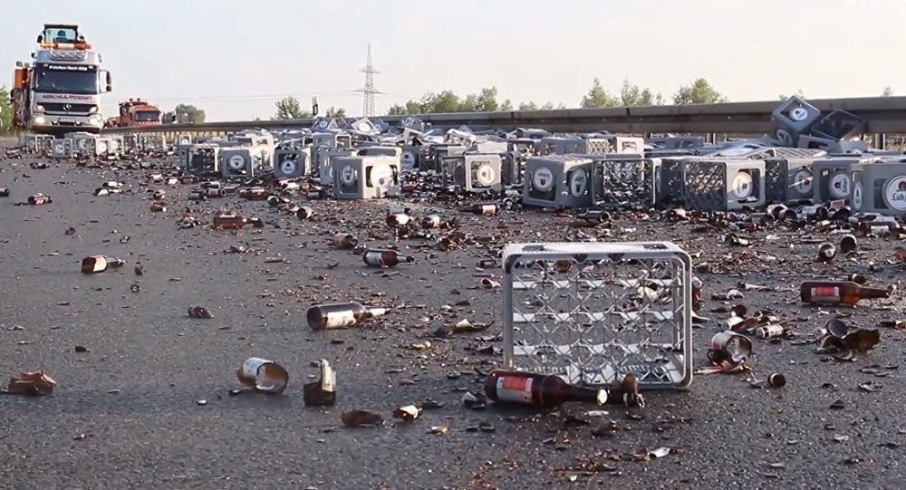 Tipsy Truck Loses its Booze: 350 Beer Crates Spill Onto German Highway