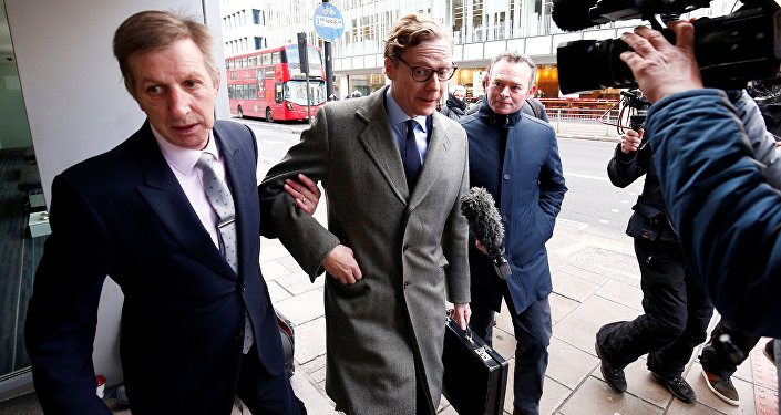 Cambridge Analytica's former CEO Alexander Nix (pictured, center) denies any wrongdoing