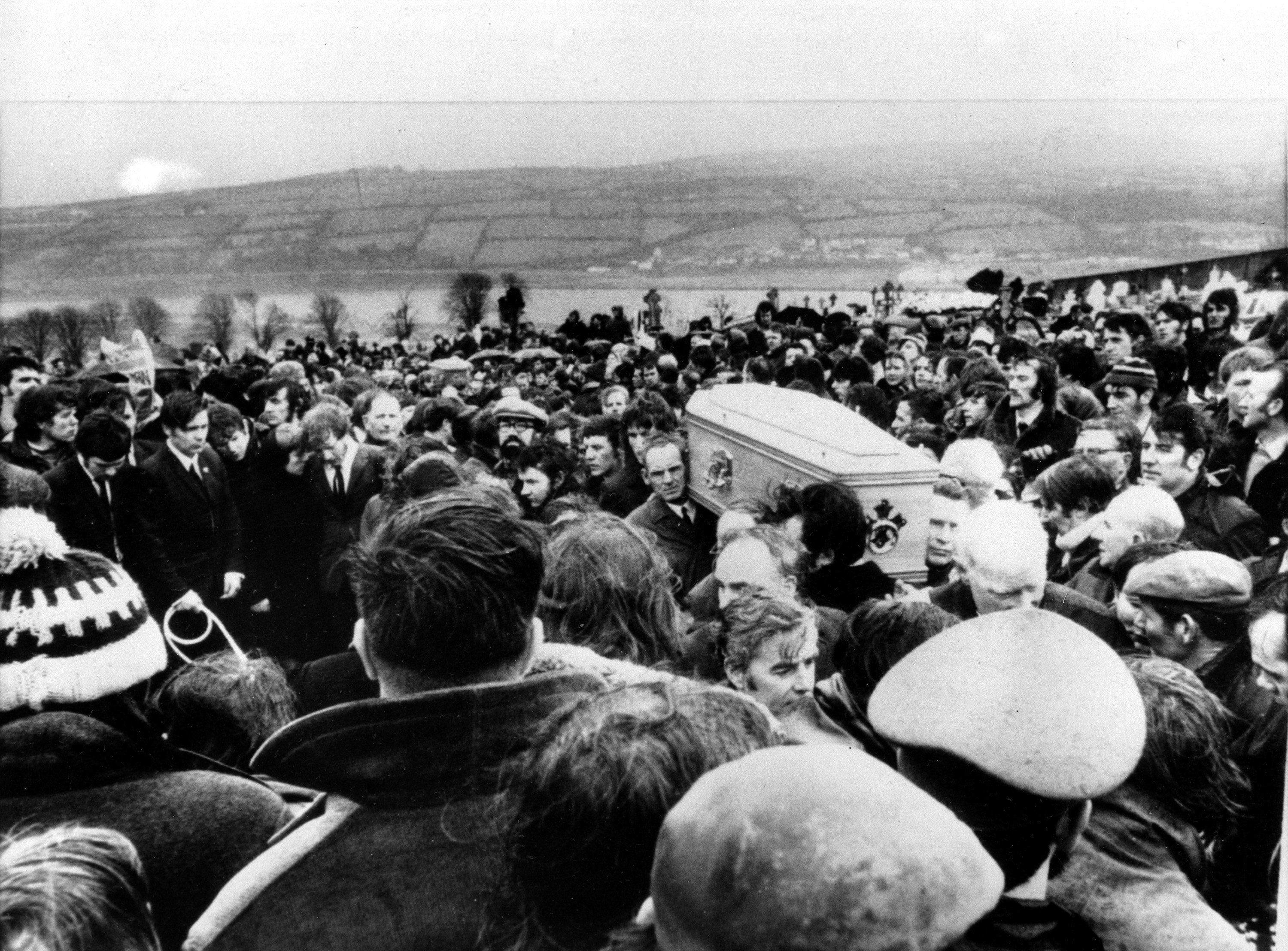 In this Feb. 2, 1972, file photo Pallbearers carry one of 13 coffins of Bloody Sunday victims to a graveside during a funeral in Derry, Northern Ireland, following requiem mass at nearby St. Mary's church at Creggan Hill.