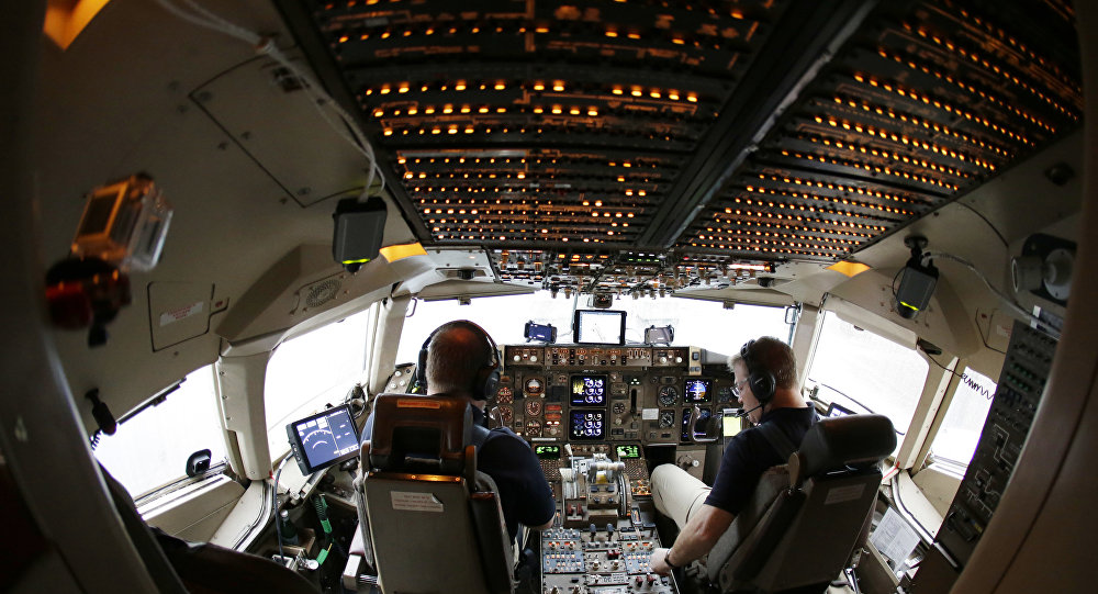 Pilots conduct a pre-flight check on their Boeing 757 airplane.