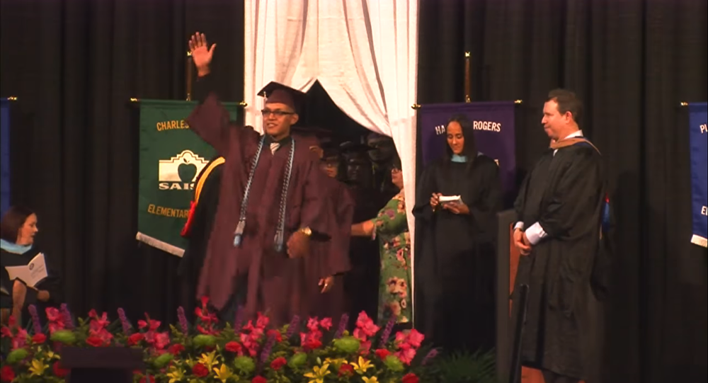 18-year-old Luis Martinez was detained after waving to his mother at his high school graduation ceremony.