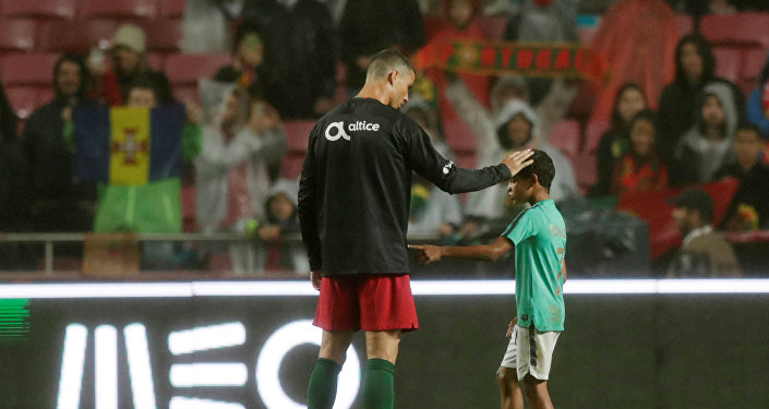 Soccer Football - International Friendly - Portugal vs Algeria - Estadio da Luz, Lisbon, Portugal - June 7, 2018 Portugal's Cristiano Ronaldo with his son after the match