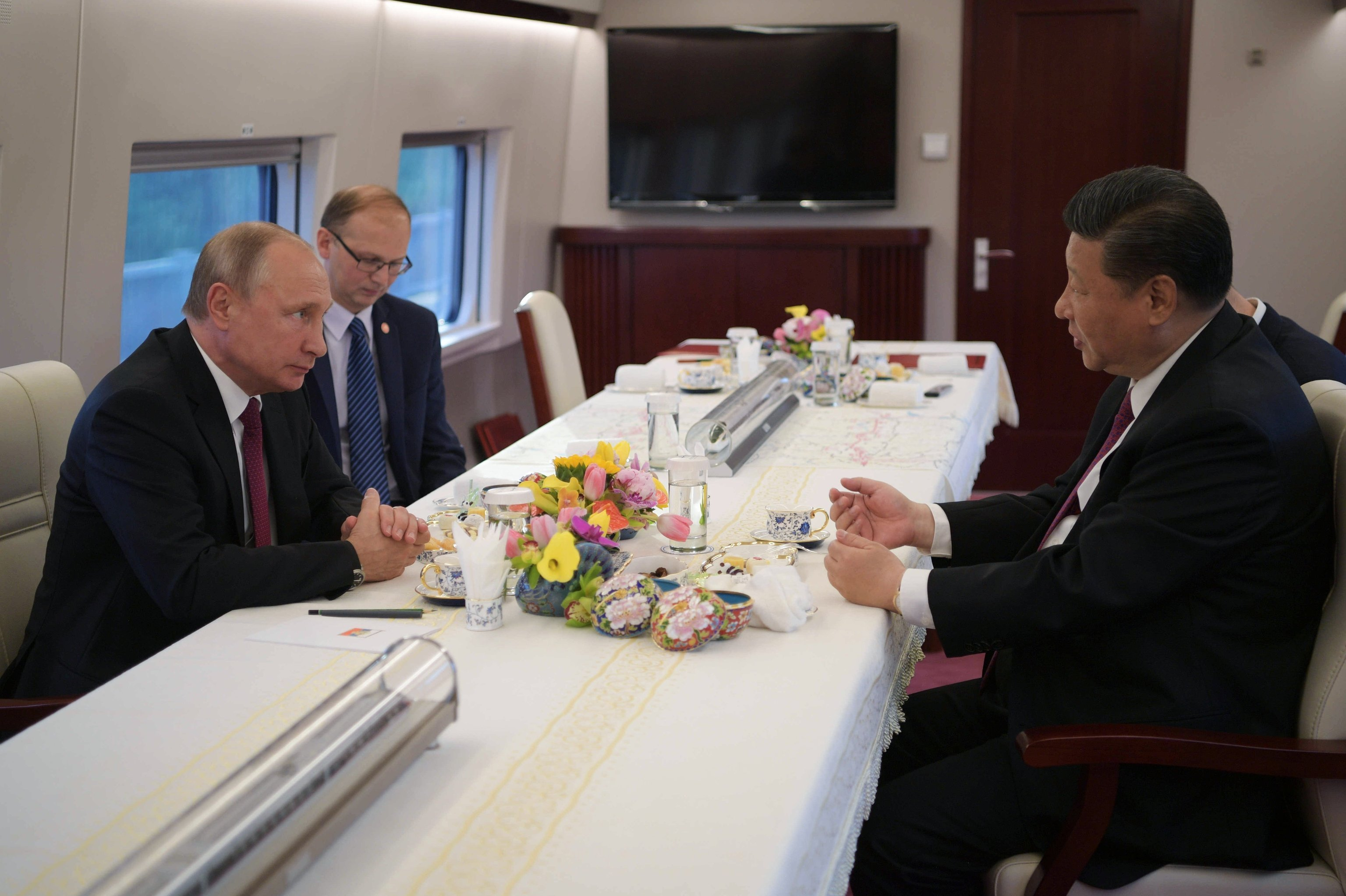 Putin and Xi talk aboard a Chinese highspeed train.