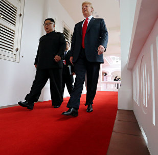 U.S. President Donald Trump walks with North Korean leader Kim Jong Un at the Capella Hotel on Sentosa island in Singapore June 12, 2018.