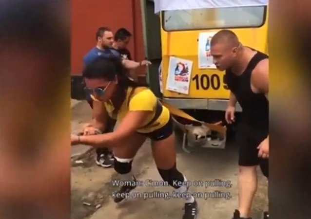 Female bodybuilder drags 22-ton tram with 50 people inside