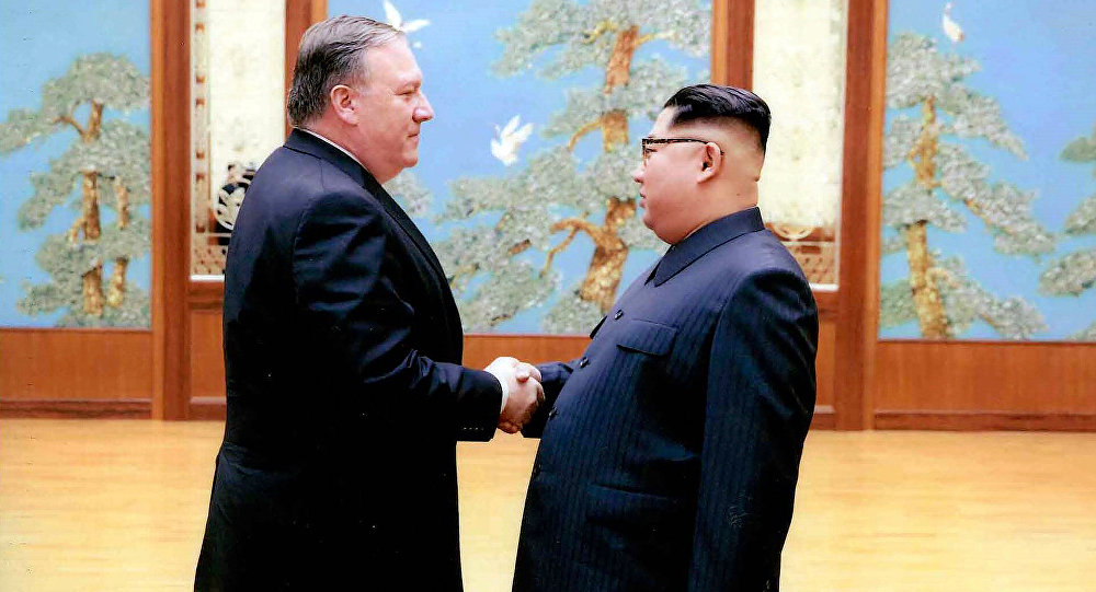 In this file photo released by the White House, then-CIA director Mike Pompeo shakes hands with North Korean leader Kim Jong-un in Pyongyang, North Korea, during a 2018 East weekend trip
