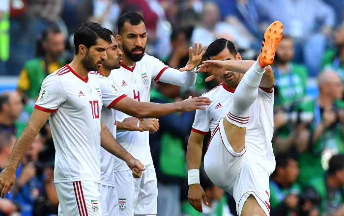 Soccer Football - World Cup - Group B - Morocco vs Iran - Saint Petersburg Stadium, Saint Petersburg, Russia - June 15, 2018 Iran's Karim Ansarifard, Rouzbeh Cheshmi and team mates before the match
