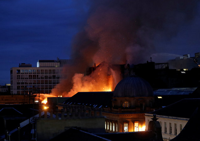 Firefighters attend to a blaze at the Mackintosh Building at the Glasgow School of Art, which is the second time in four years, Glasgow, Scotland, Britain, June 16, 2018