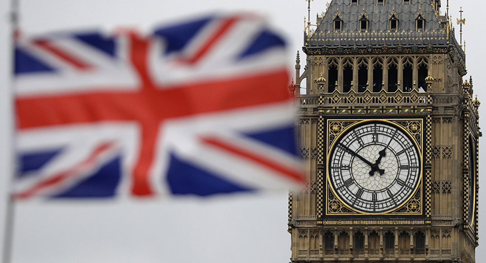 A British flag is blown by the wind near Big Ben in front of the UK Houses of Parliament in central London.
