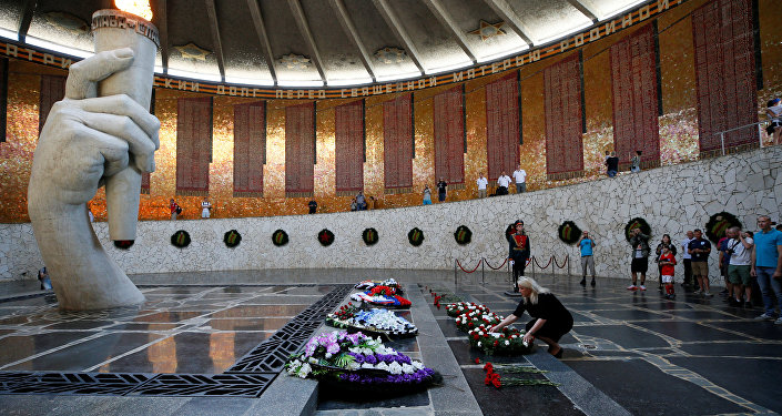 Deputy British Ambassador to Russia Lindsay Skoll attends a wreath laying ceremony at the Mamayev Kurgan World War Two memorial complex in Volgograd, Russia June 18, 2018