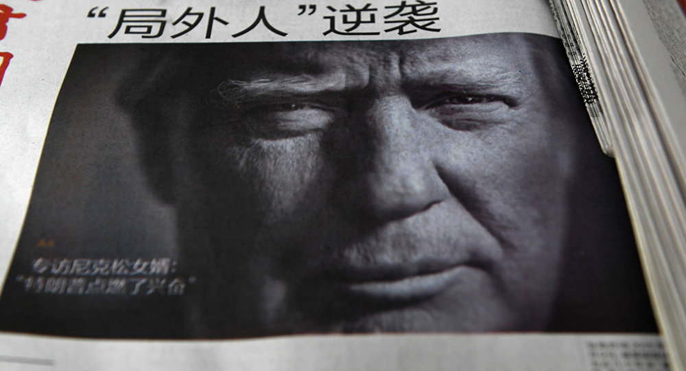 A newspaper featuring a photo of US President-elect Donald Trump at a news stand in Beijing
