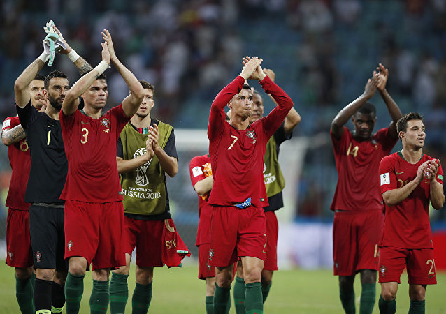 Portugal players applaud their fans after their first World Cup game against Spain on Friday, June 15